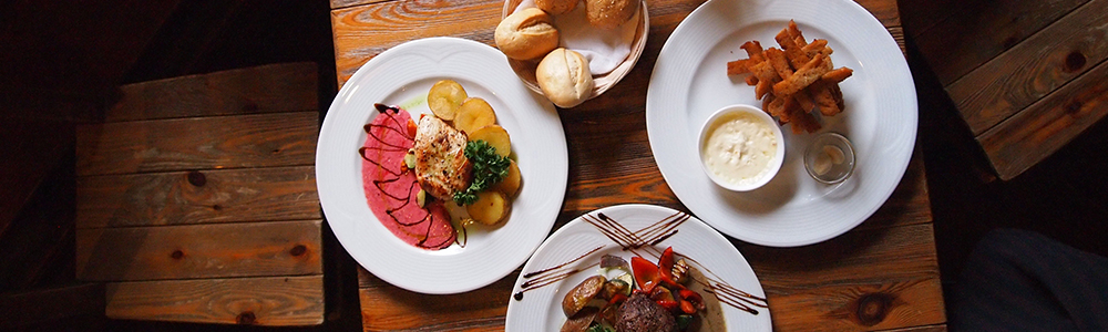 Photo of fine dining food on white plates